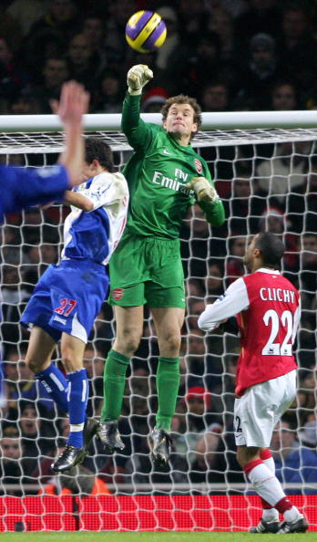 Arsenal's Goalkeeper (C) punches out the